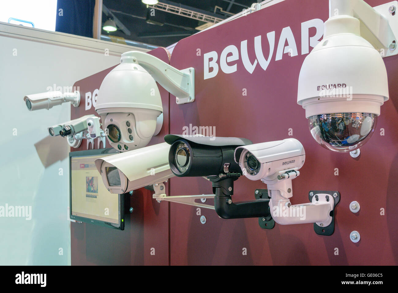Video surveillance cameras at showcase of the company 'BeWard' on electrotechnical forum in the building - Stock Image