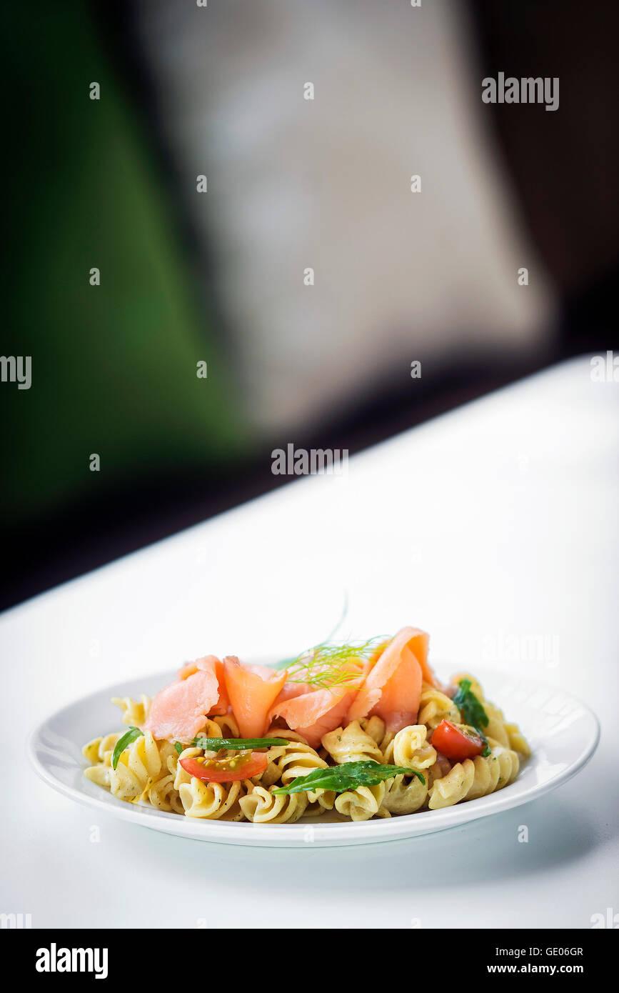 smoked salmon organic tomato and basil fresh pasta salad with ricotta cream sauce and dill - Stock Image