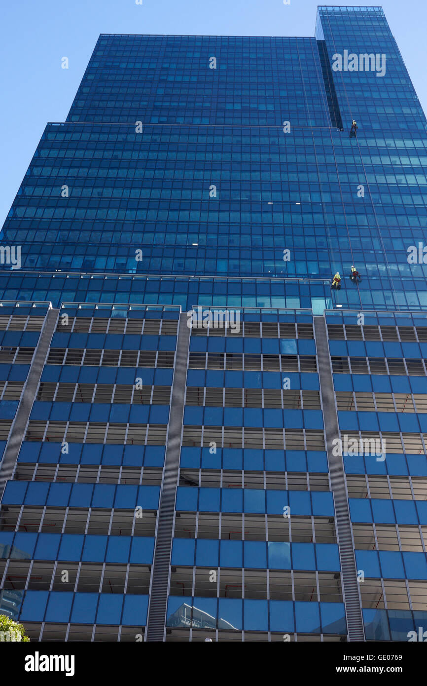 Window cleaners at work at Portside Tower, currently the tallest building in Cape Town, South Africa. - Stock Image