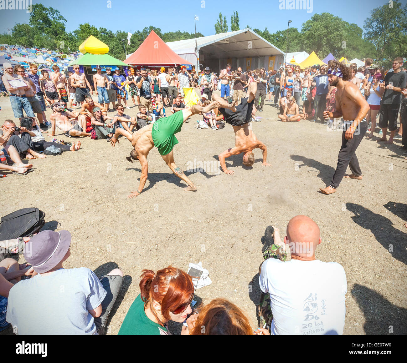 People watching capoeira show during 21th Woodstock Festival Poland. - Stock Image