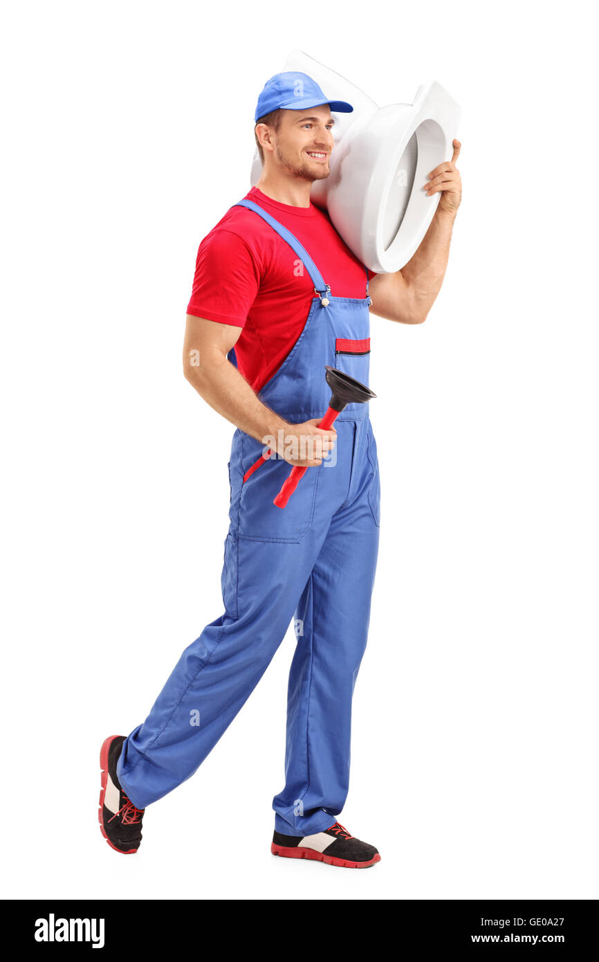 Full length portrait of a cheerful male plumber carrying a toilet and a plunge isolated on white background - Stock Image