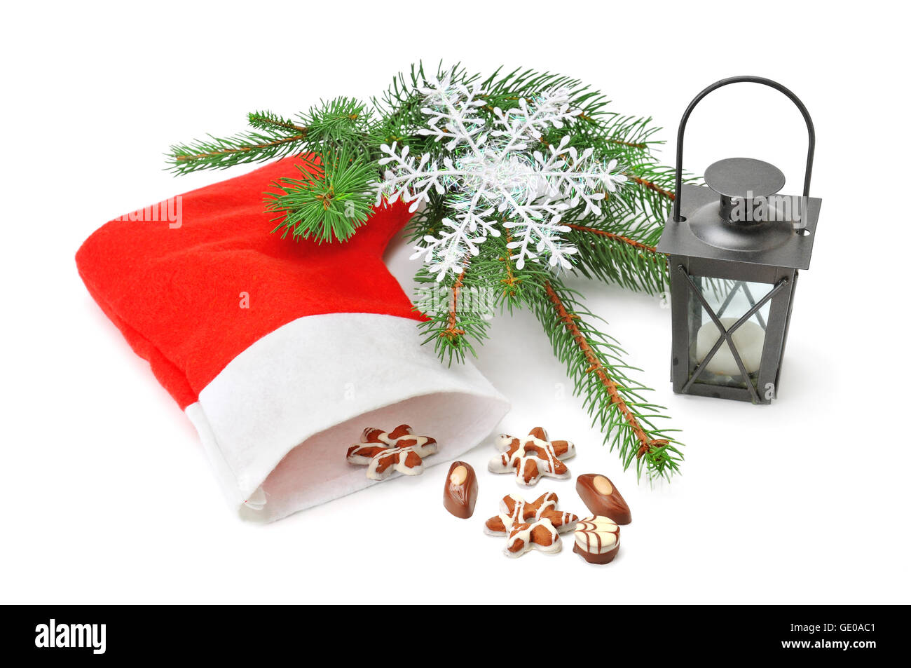 Christmas Stocking, lantern and spruce isolated on white background - Stock Image