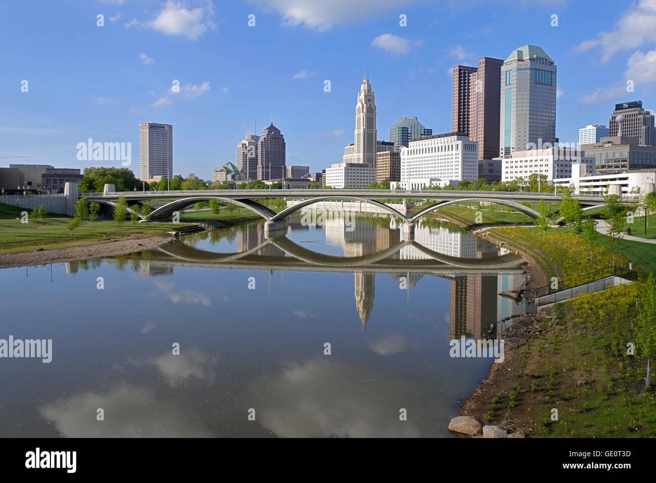 Landscape image of Columbus Ohio Skyline in the USA showing sky scrapers on  banks of River Scioto great reflections of bridge and buildings on river - Landscape Image Of Columbus Ohio Skyline In The USA Showing Sky