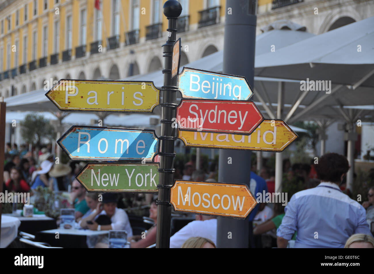 Rusty Sign showing directions to Beijing, Sydney, Madrid, Paris, Rome, New York and Moscow, from Lisbon, Portugal - Stock Image