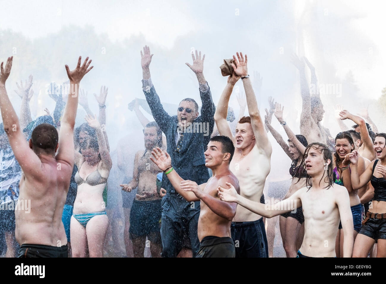 People enjoying water curtain at the19th Przystanek Woodstock (Woodstock Festival). - Stock Image