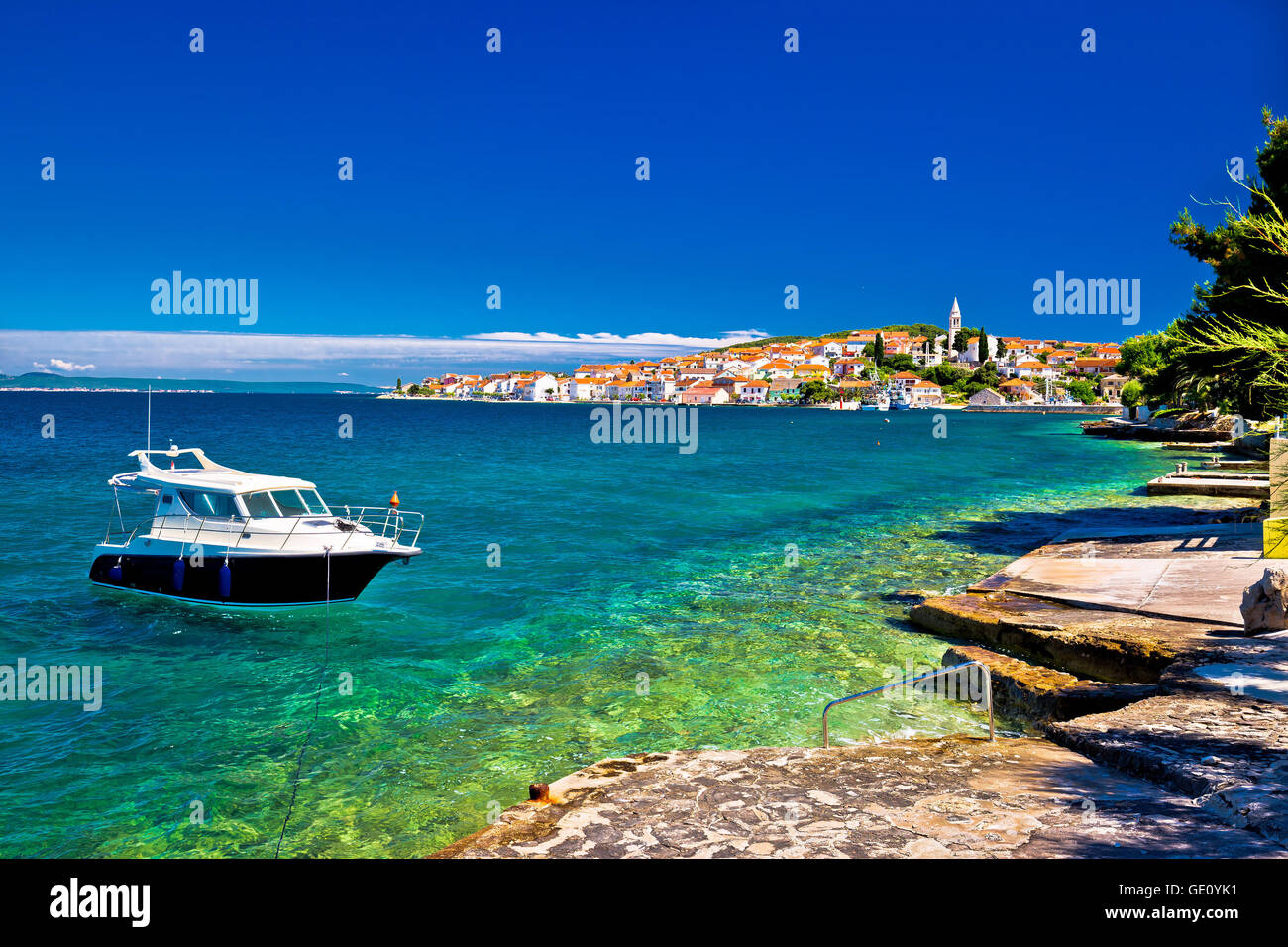 Kali beach and boat on turquoise sea, Island of Ugljan, Croatia - Stock Image