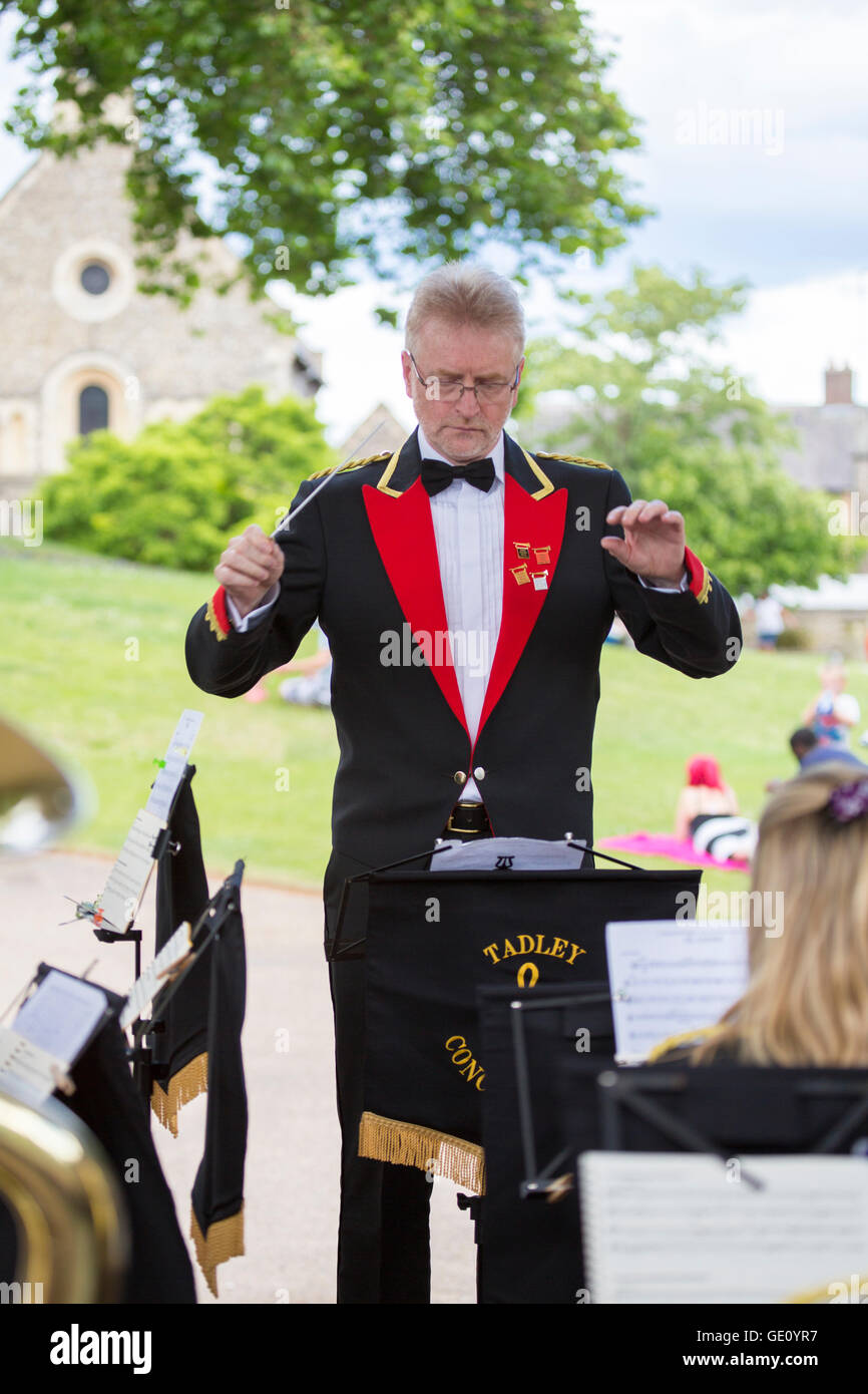 A man conducts a brass band in Forbury Gardens, Berkshire, UK Stock Photo
