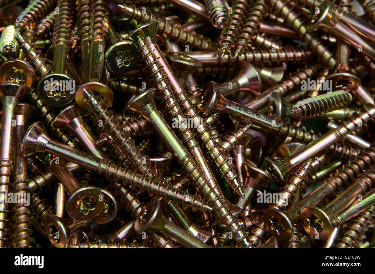 A whole lot of new Torx wood screws of same type - or is there an intruder? - Stock Image