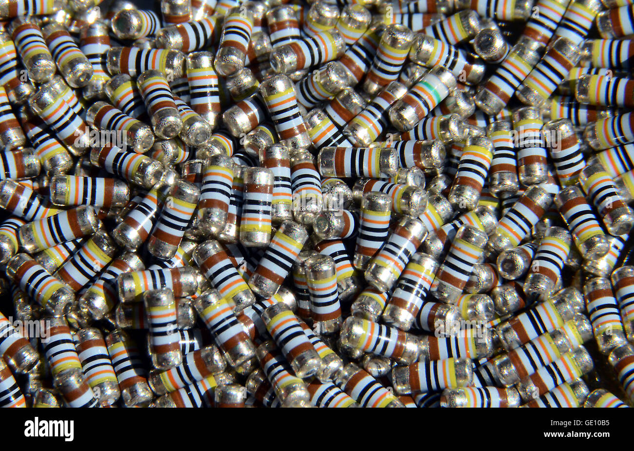 A large number of identical new unused SMD resistors. Or wait, are they all identical? Find the deviant! - Stock Image