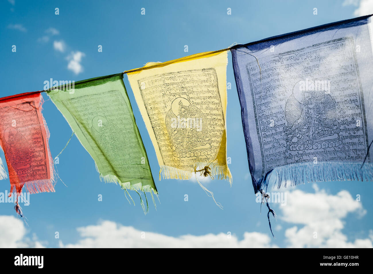 Buddhist Red Green Yellow And Blue Flags Flying In The Himalayas