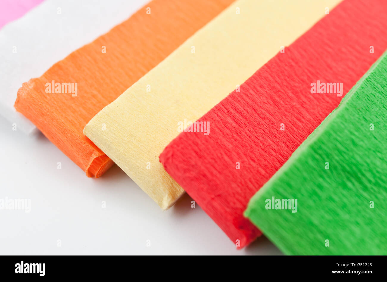rainbow color paper isolated on white background. - Stock Image