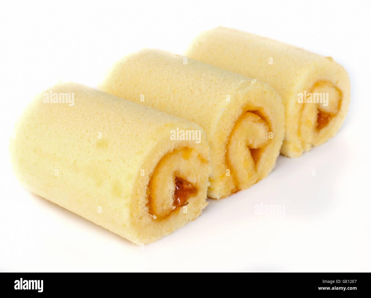 Sweet roll cake with orange jam isolated on white - Stock Image