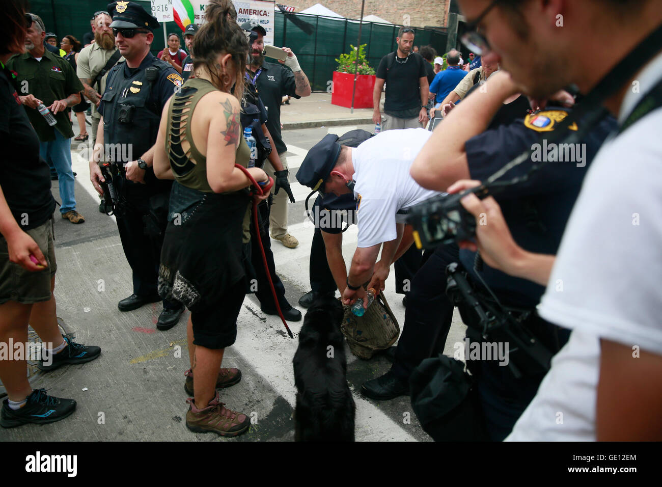 07212016 - Cleveland, Ohio, USA:  Cleveland police officers search a woman's bag without her permission near - Stock Image