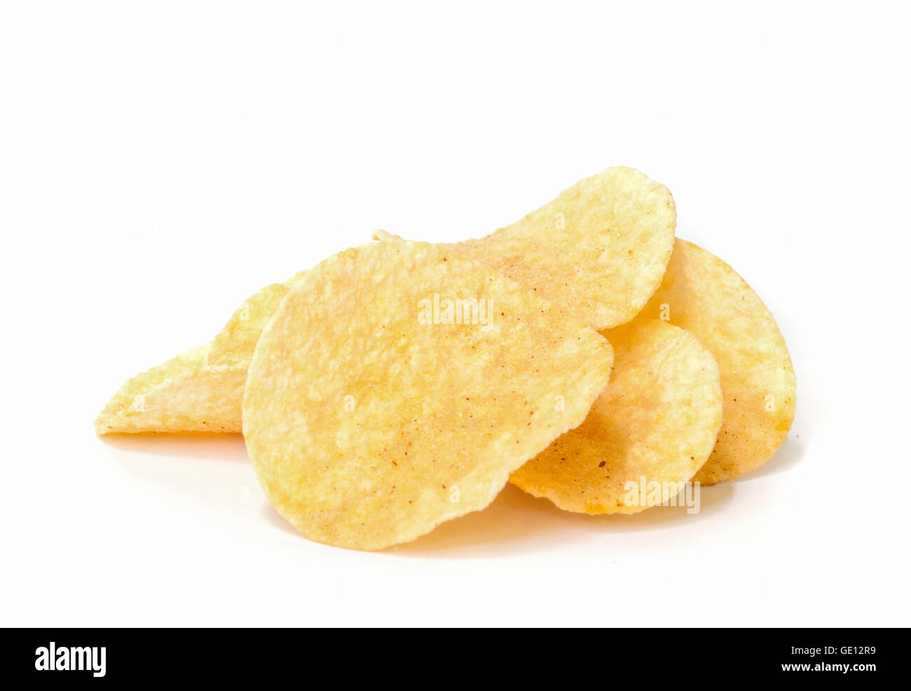 crunchy potato chips on white background. - Stock Image
