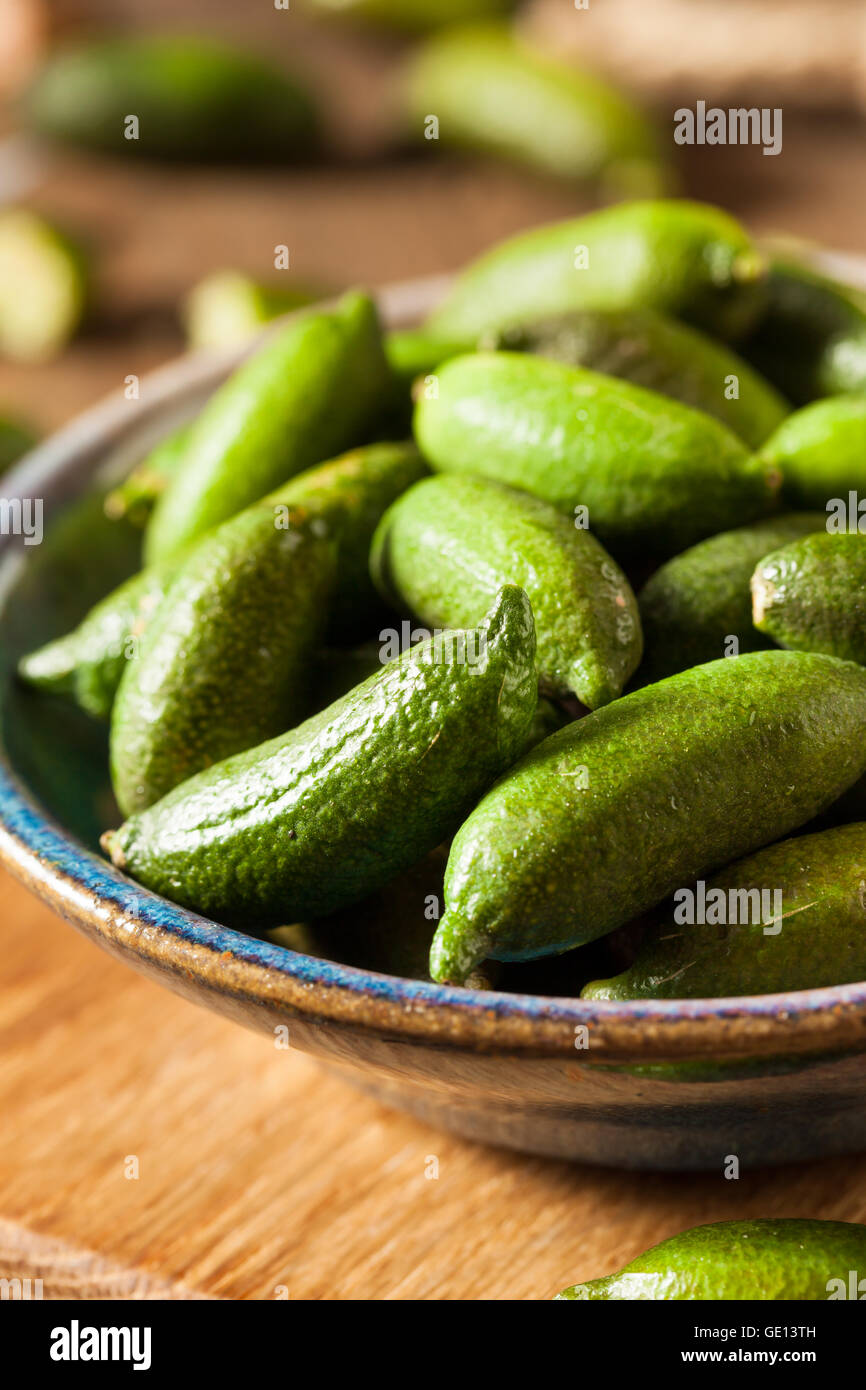 Raw Organic Green Finger Limes Ready for Eating - Stock Image