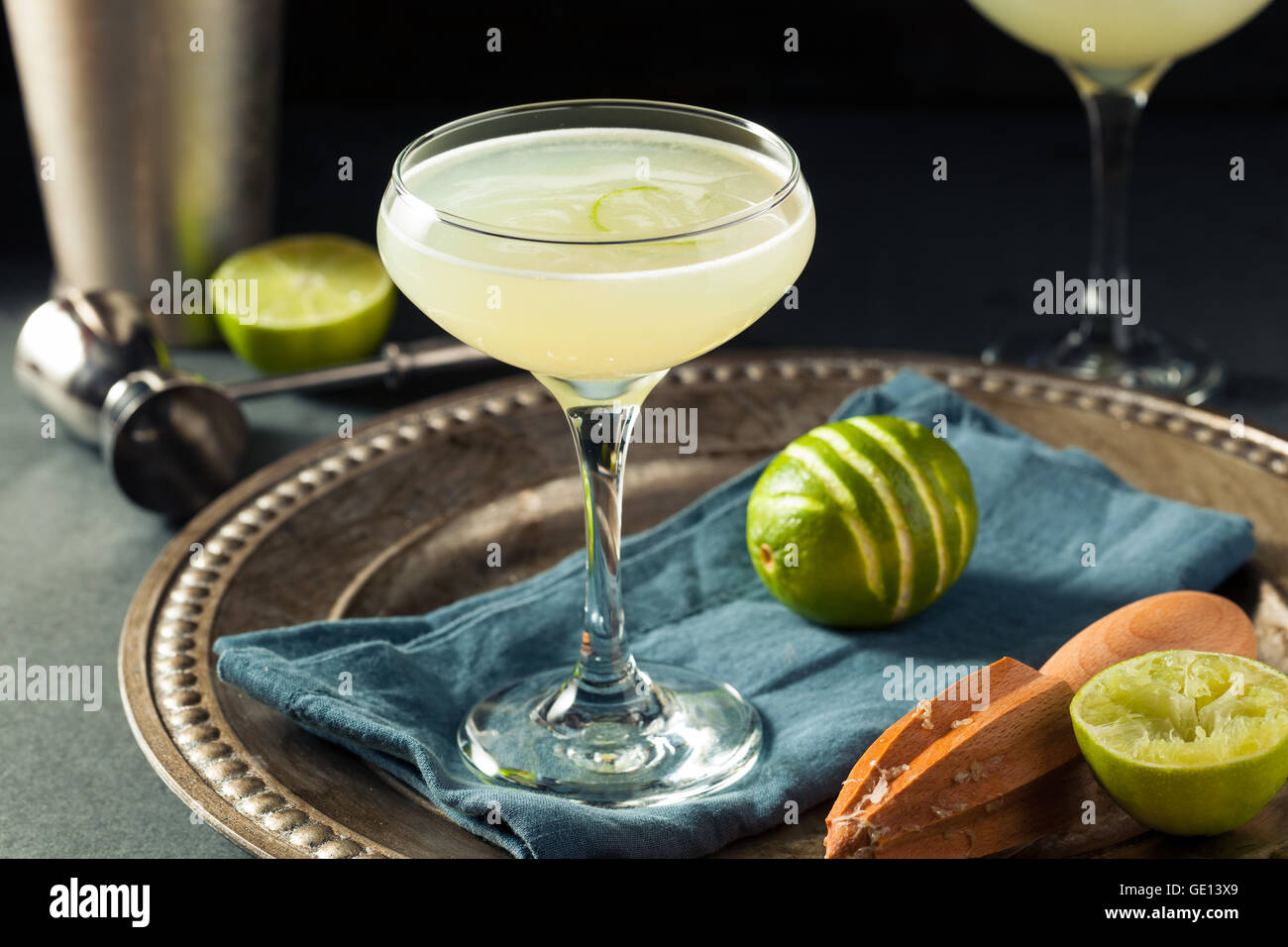 Alcoholic Lime and Gin Gimlet with a Garnish - Stock Image