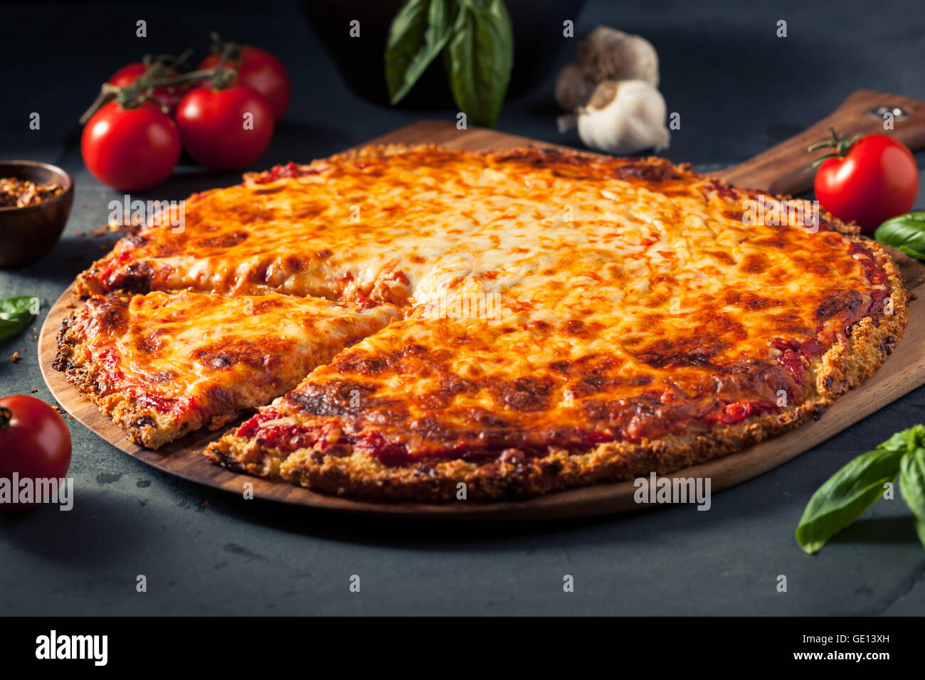 Healthy Homemade Quinoa Crust Cheese Pizza with Basil - Stock Image