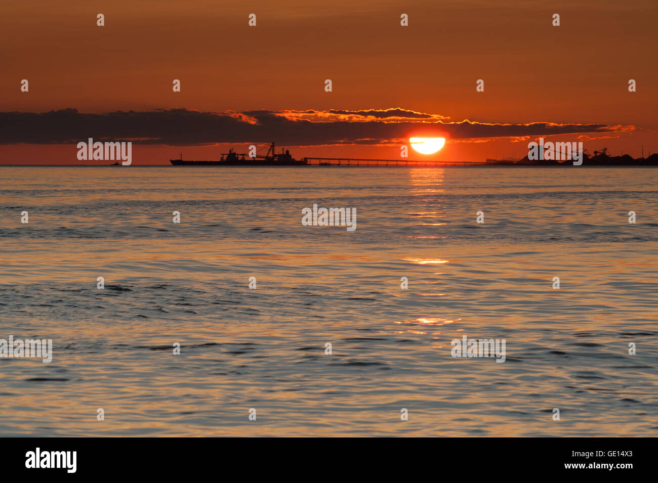 ship silhouette at sunset on Pacific ocean at Point Roberts, Washington, USA - Stock Image