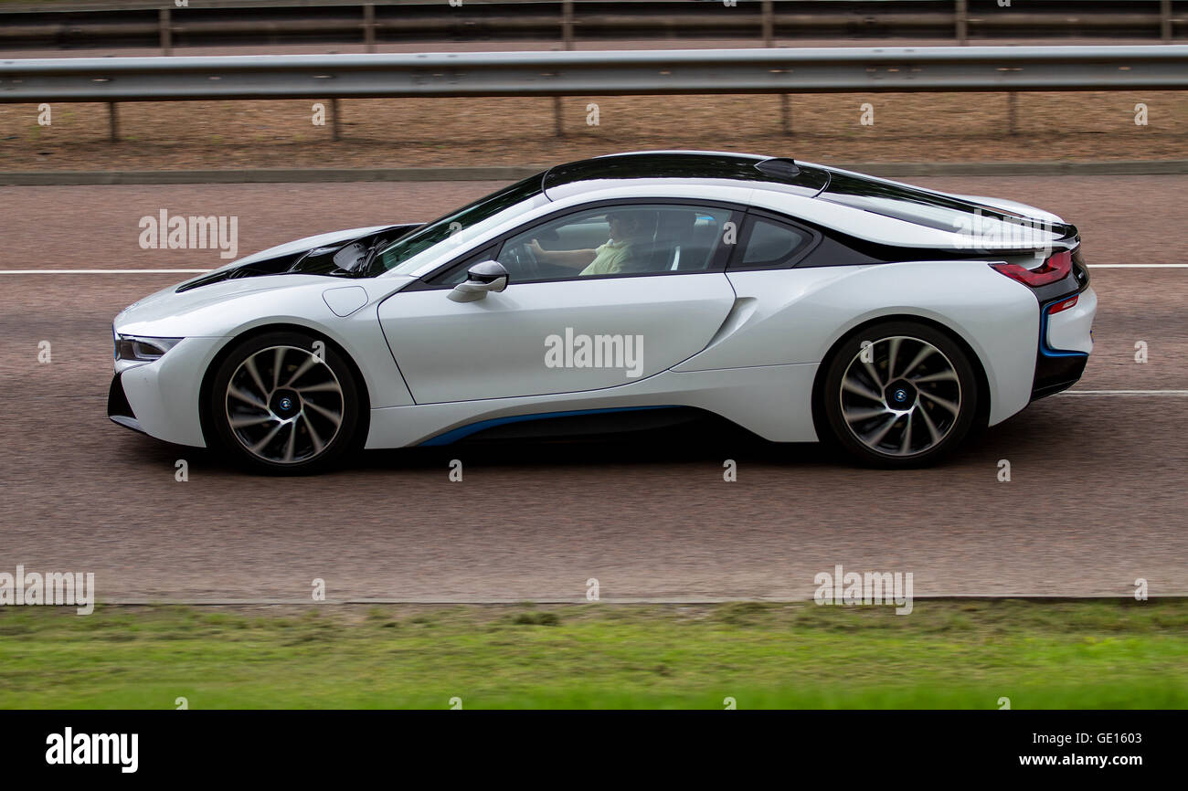 A Silver And Black Bmw I8 Plug In Hybrid Sports Car Travelling Along