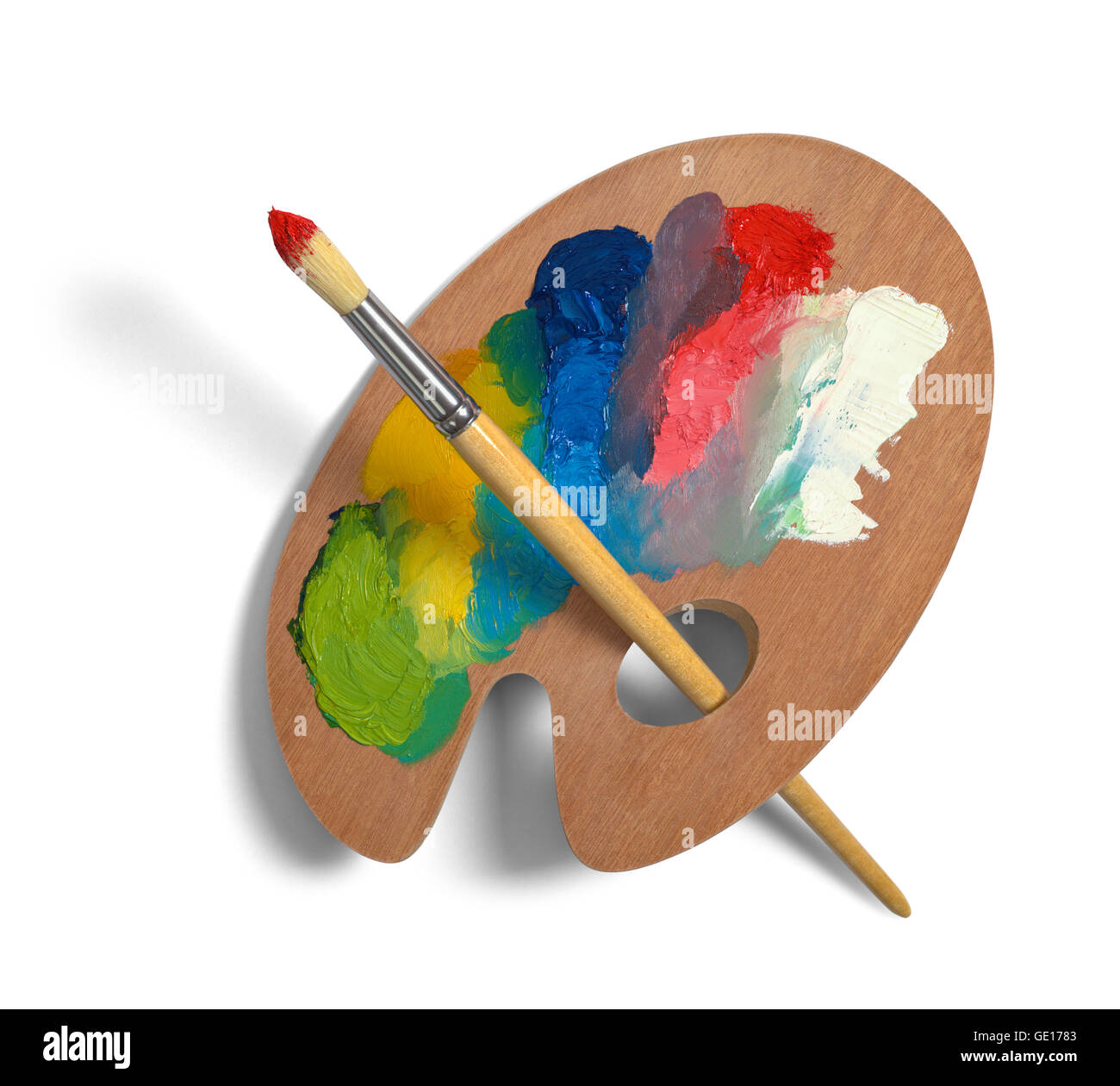 Painters Palette with Mixed Paints and Brush Isolated on White Background. - Stock Image