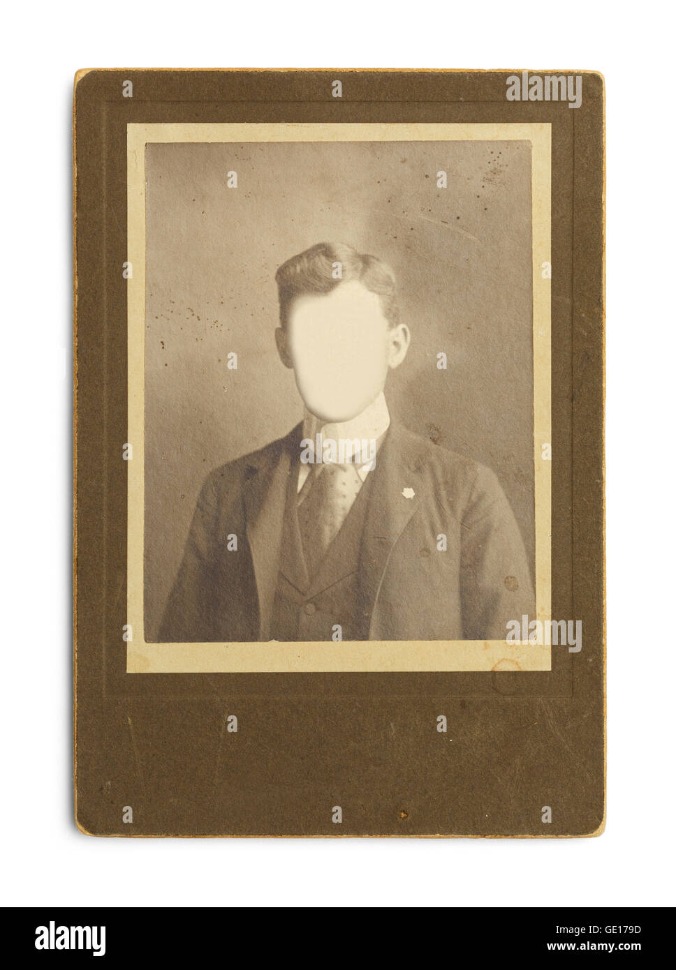 Old Antique Photo of Man With Face Cut Out Isolated on White Background. - Stock Image