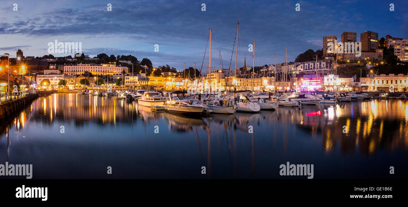 GB - DEVON: Torquay Harbour and Town by night - Stock Image