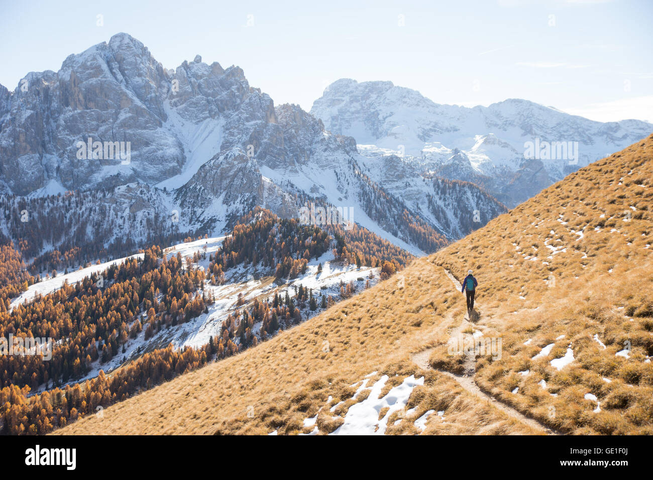Woman hiking in the Dolomite Mountains, South Tyrol, Italy Stock Photo