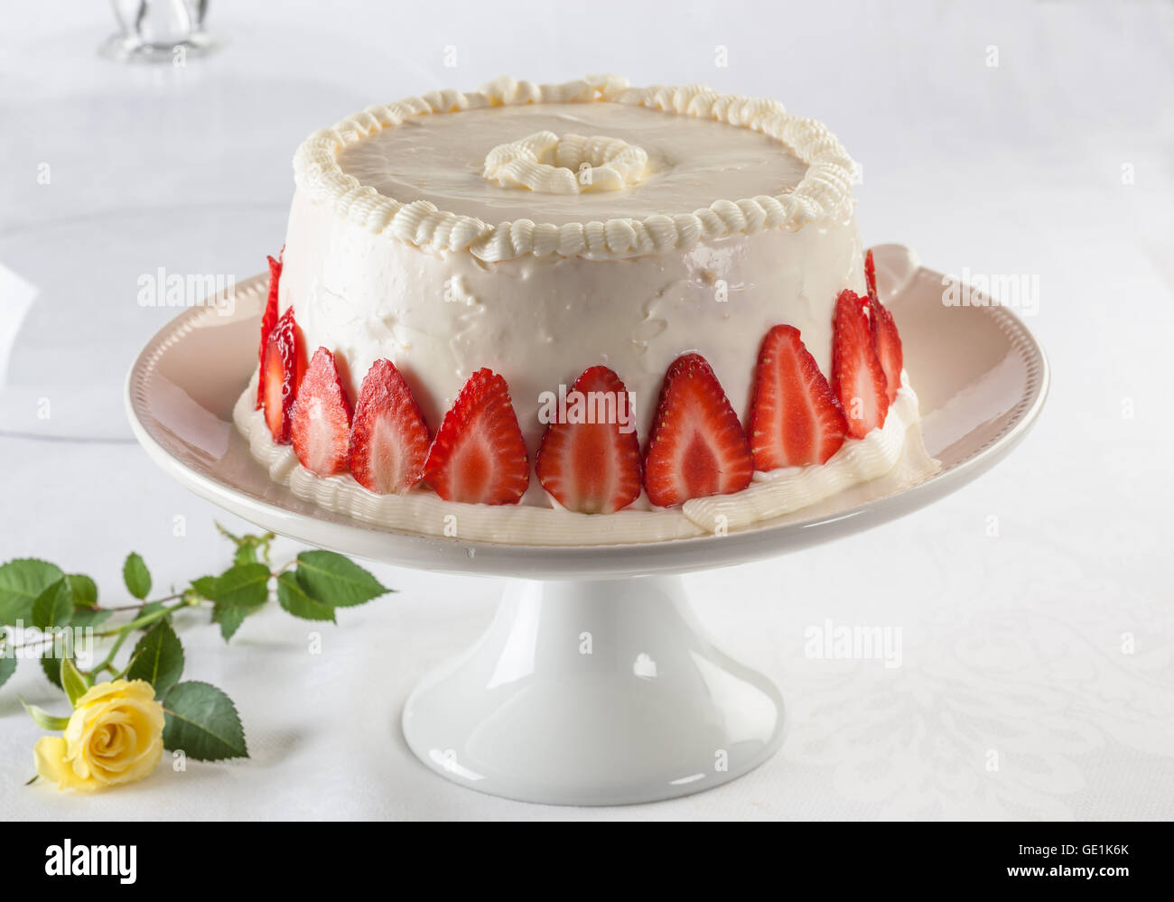 Angel food cake, or angel cake, is a type of sponge cake made with stiffly beaten egg whites with no addition of - Stock Image
