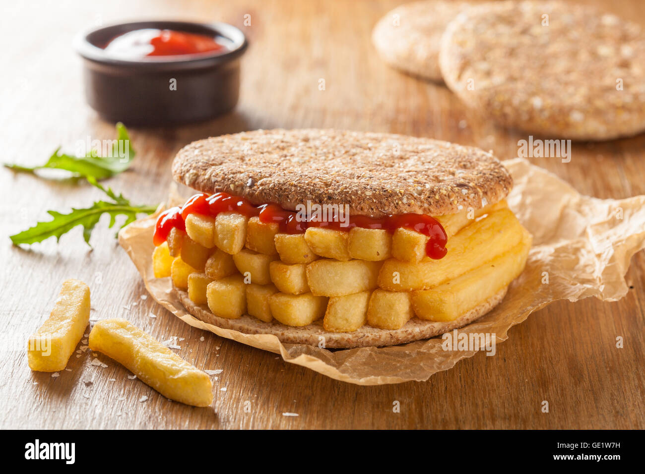 Chip Butty sandwich with potato chips or fries and ketchup - Stock Image