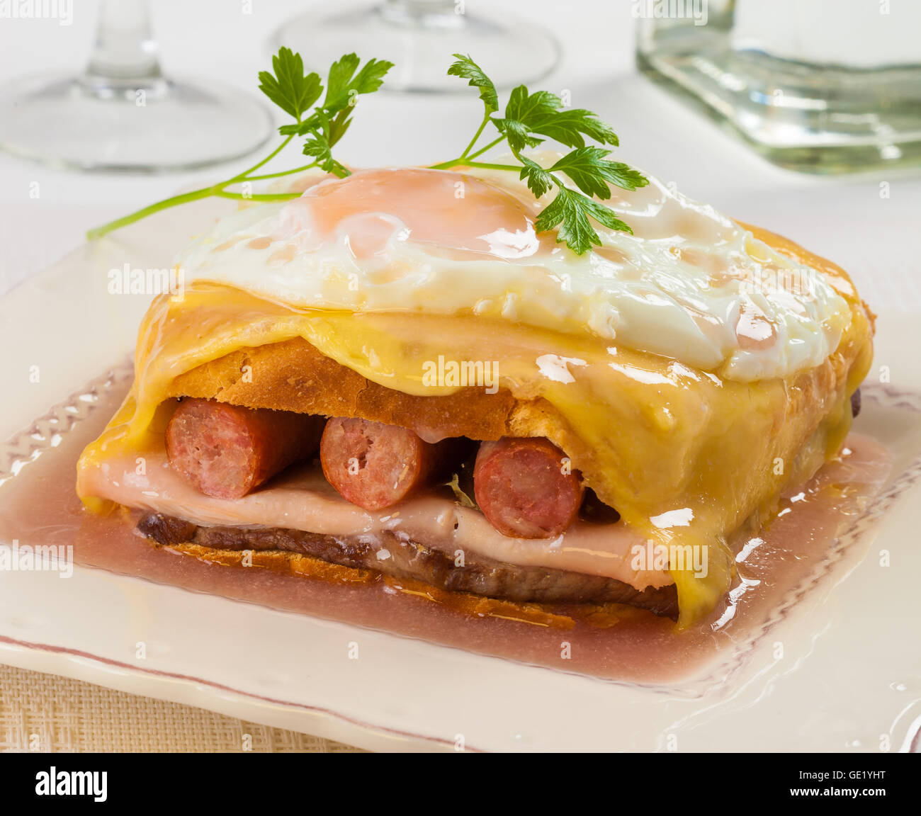 Francesinha on plate, typical food from Porto, Portugal. With fried egg. Stock Photo