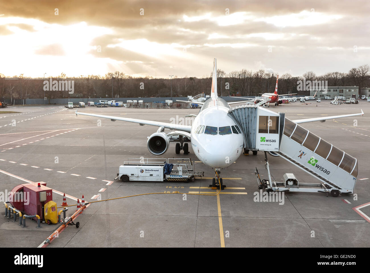 Sunset over plane at the Tegel airport. Stock Photo