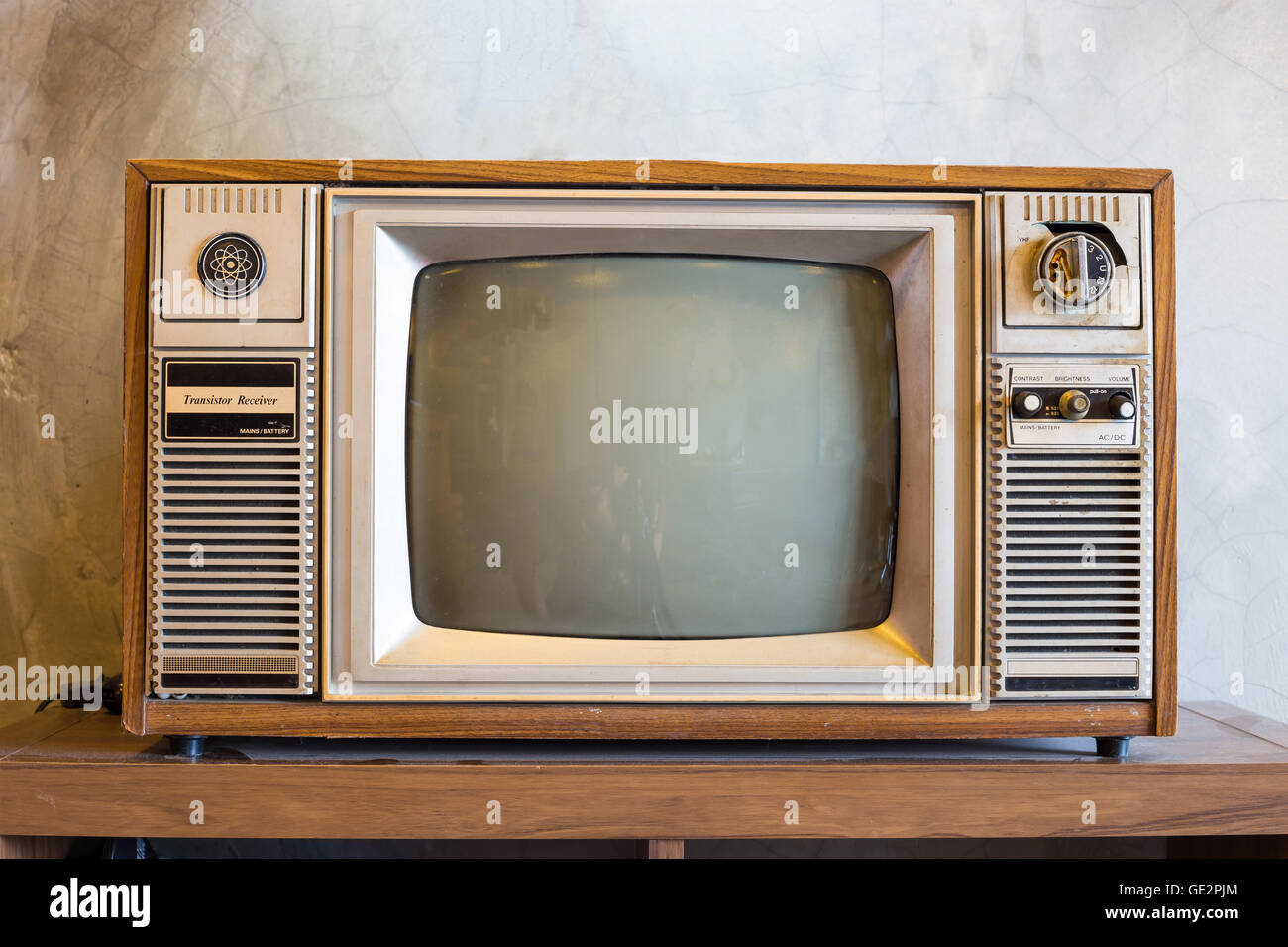 retro tv with wooden case in room with vintage wallpaper. Black Bedroom Furniture Sets. Home Design Ideas