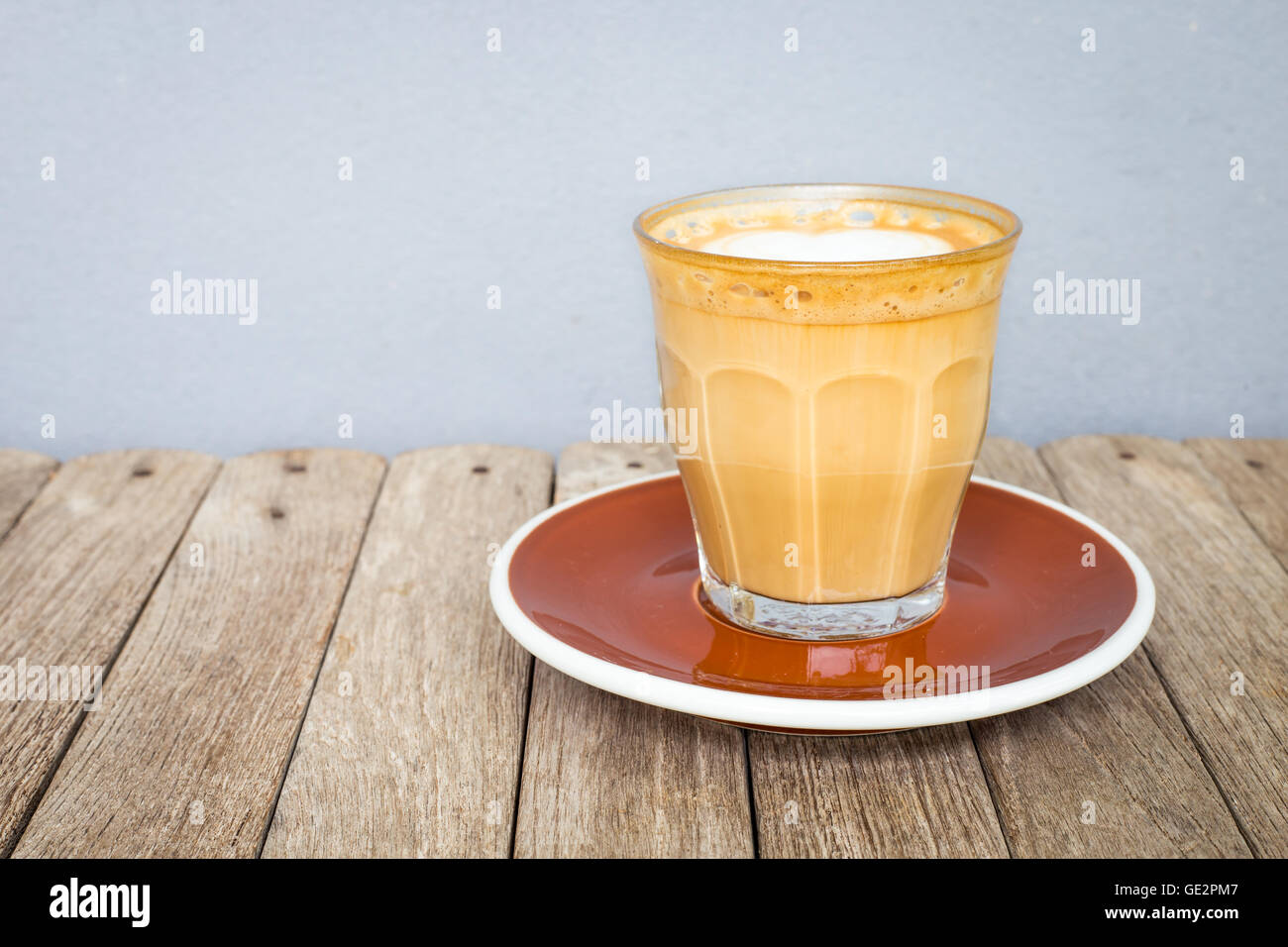 Latte Art Coffee In Glass Clear Cup On Wood Table Stock Photo Alamy