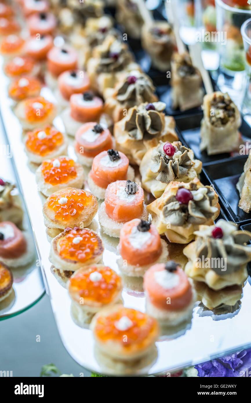 Assortment of canapés. Banquet service. - Stock Image