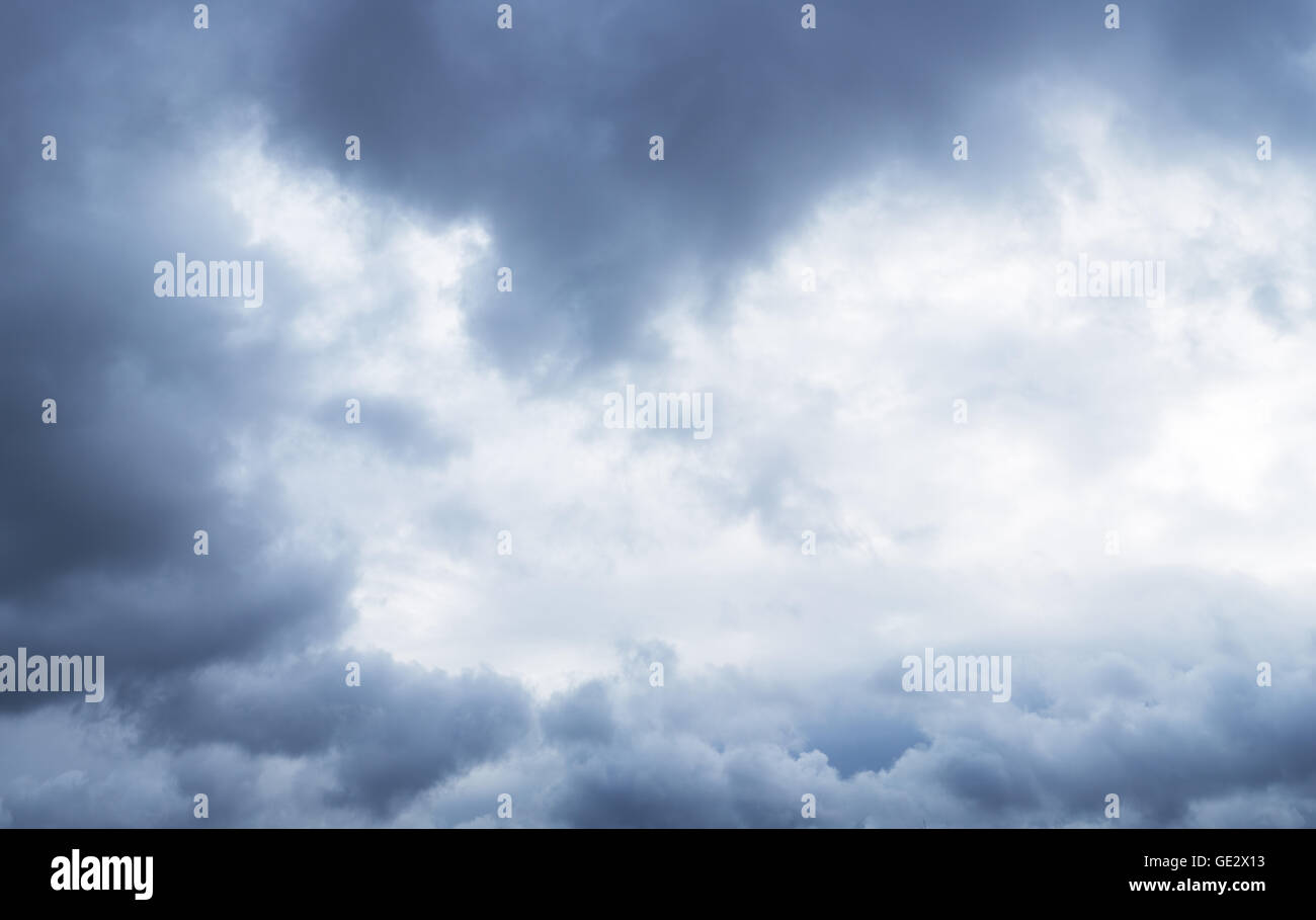 Heavy gray clouds in the sky before snow falling. - Stock Image