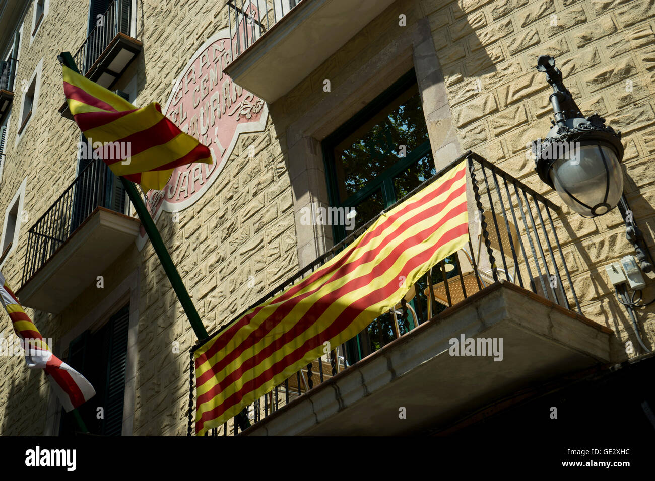 Catalonian flag in a balcony in the old Gothic quarter in Barcelona. Catalonia. Spain - Stock Image
