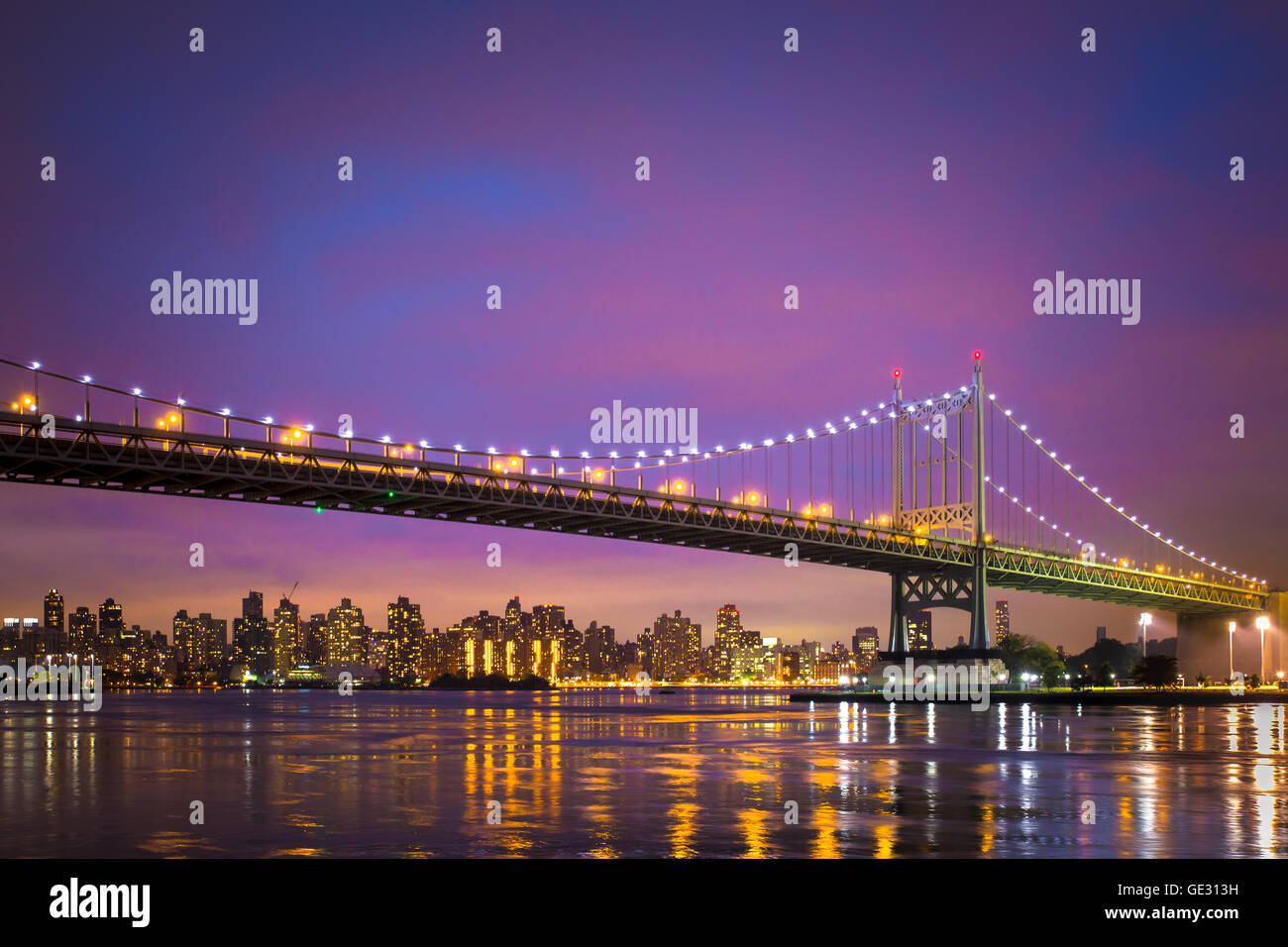 View of the Robert J. Kennedy RFK Bridge in New York City from Astoria Queens to Manhattan seen just after sunset - Stock Image