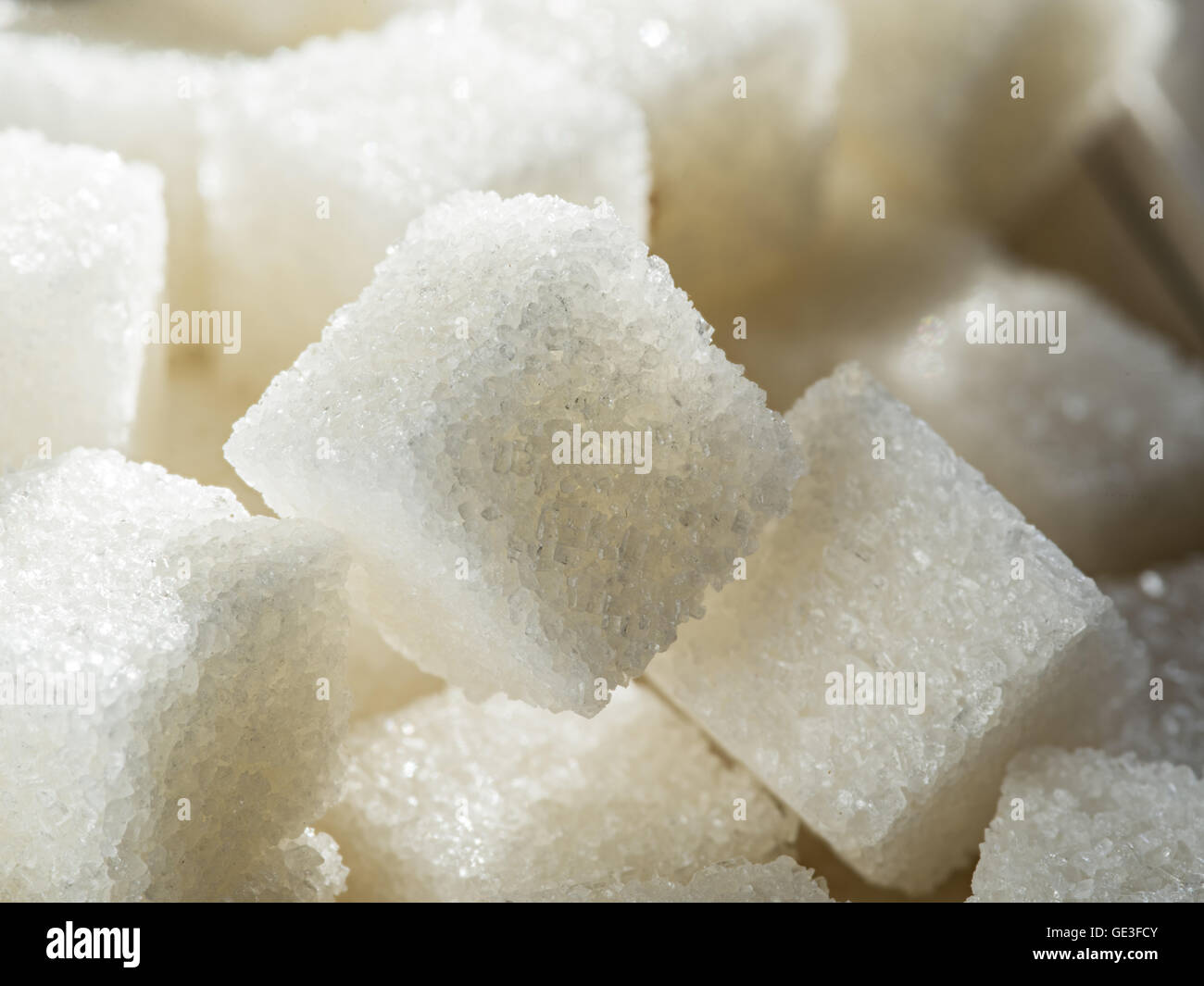 Close up shot of white refinery sugar. - Stock Image