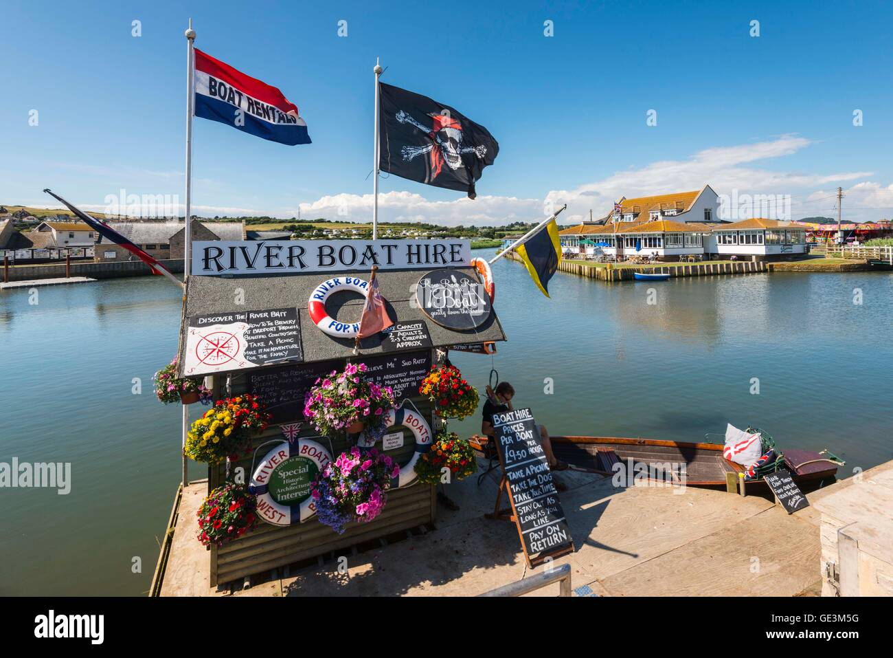 West Bay, Dorset, UK. 22nd July 2016.  UK Weather.  Wall to wall sunshine and blue sky above the Rive Boat Hire - Stock Image