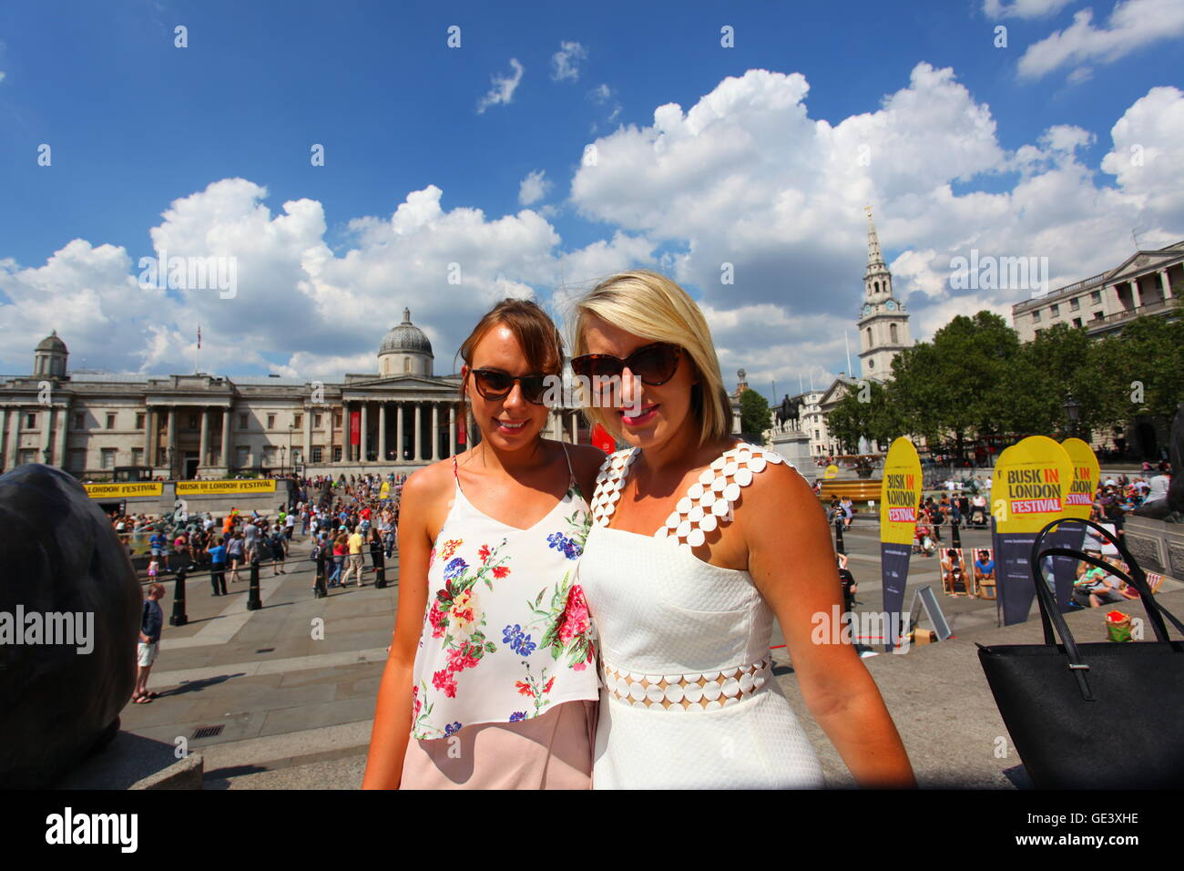 London, Great Britain. 23rd July, 2016. Two women enjoying the glorious hot weather that England is having at the - Stock Image