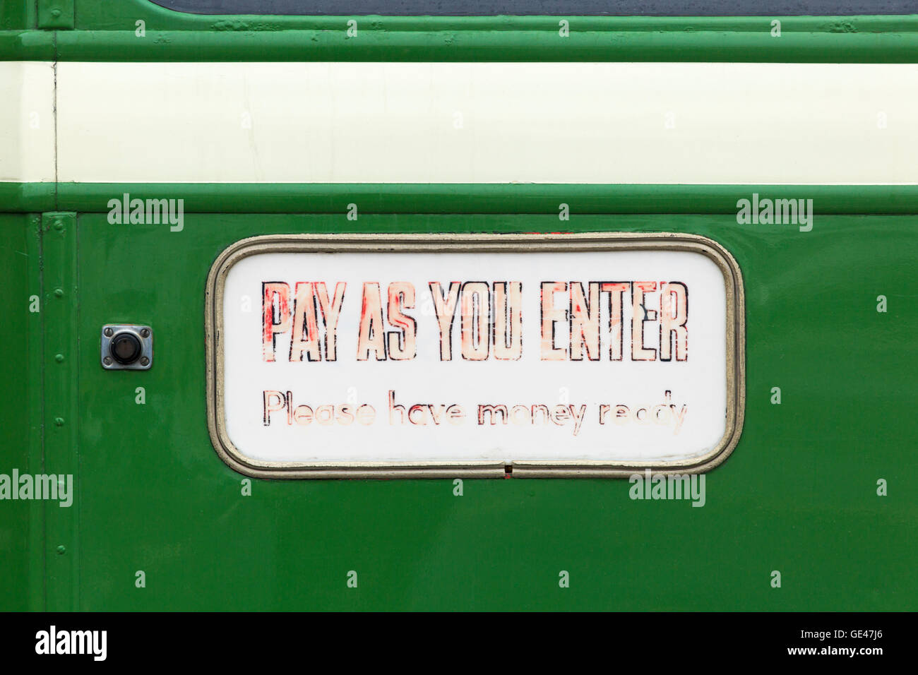 Pay as you enter please have money ready faded sign on bus at Poole to celebrate Hants & Dorset (More Bus) centenary - Stock Image