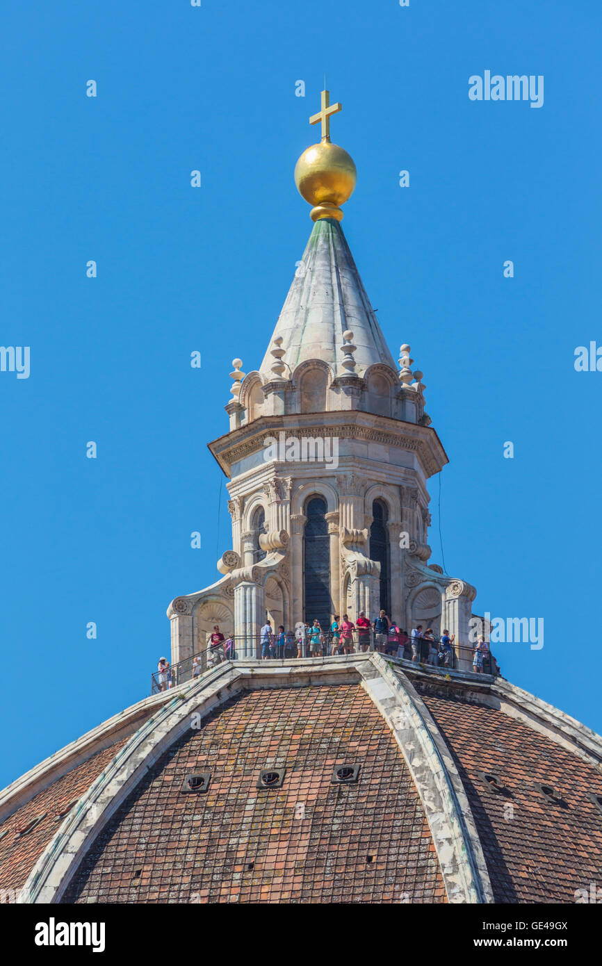 Florence, Florence Province, Tuscany, Italy.  The dome of the Duomo, or cathedral.  Visitors admire the city from Stock Photo