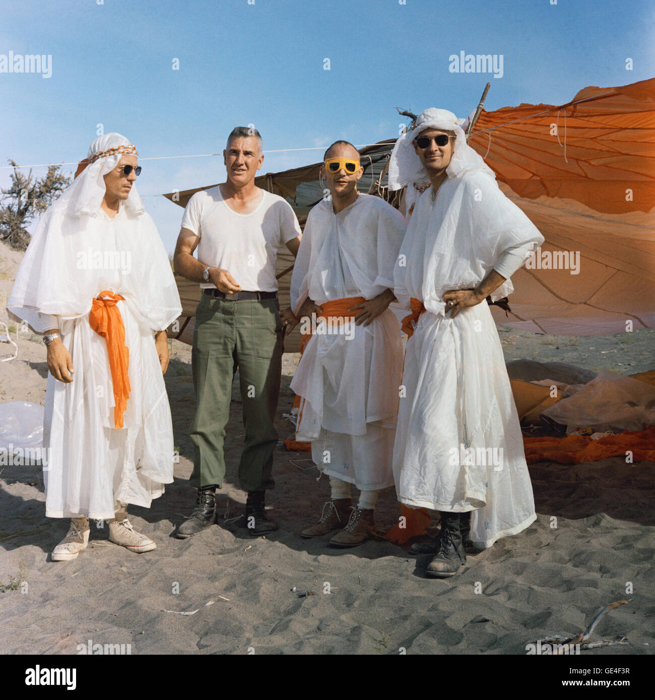 (August 14, 1967) Three astronauts participating in Apollo desert survival training in Washington state pose with Stock Photo