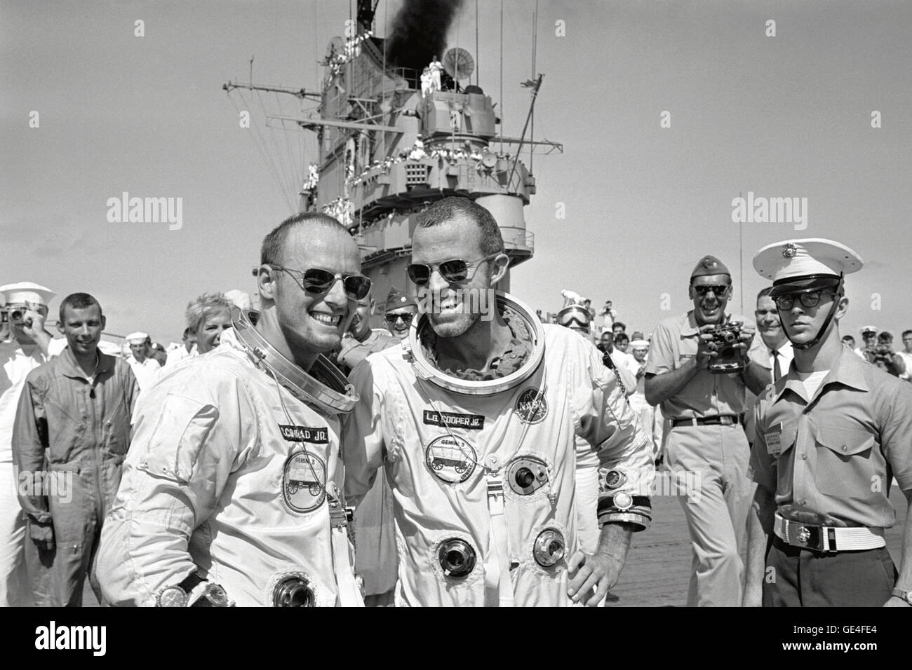 (August 29, 1965) Astronauts L. Gordon Cooper Jr. (right) and Charles Conrad Jr. walk across the deck of the recovery Stock Photo