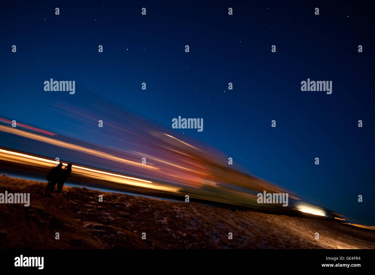 Description: The Soyuz TMA-17 spacecraft is seen in this long exposure as it is rolled out by train to the launch - Stock Image