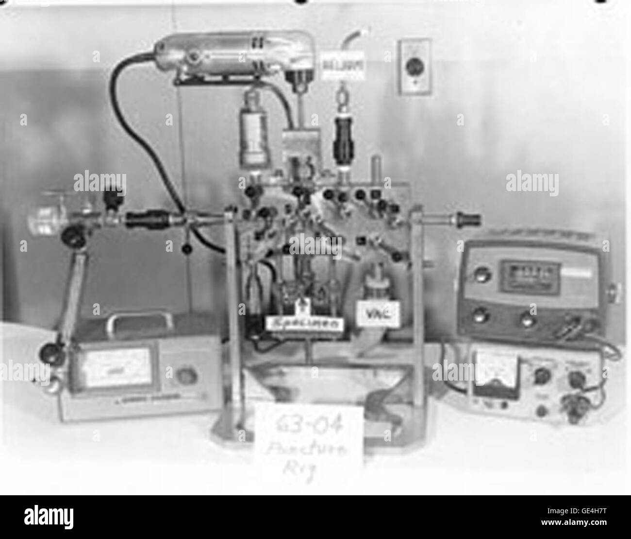 Puncture rig. Puncture rigs were used to penetrate the outer capsule of each experiment and measure the pressure - Stock Image