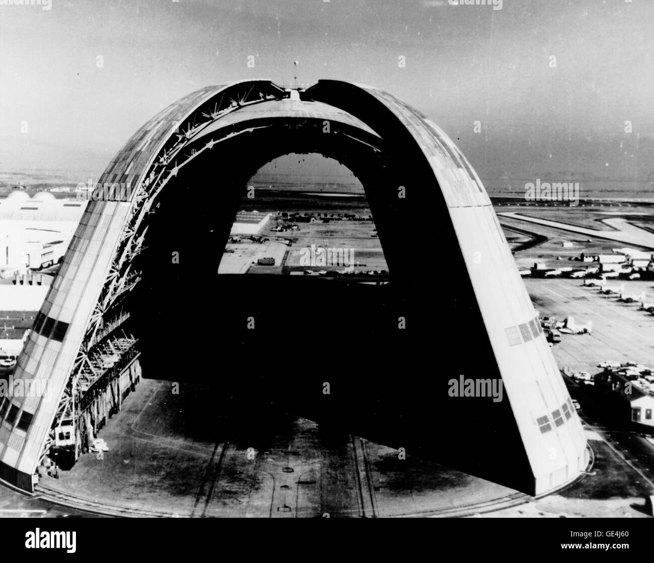 This is a view of the huge dirigible hangar with doors open at both ends at the NASA Ames Reserach Center, Moffett - Stock Image
