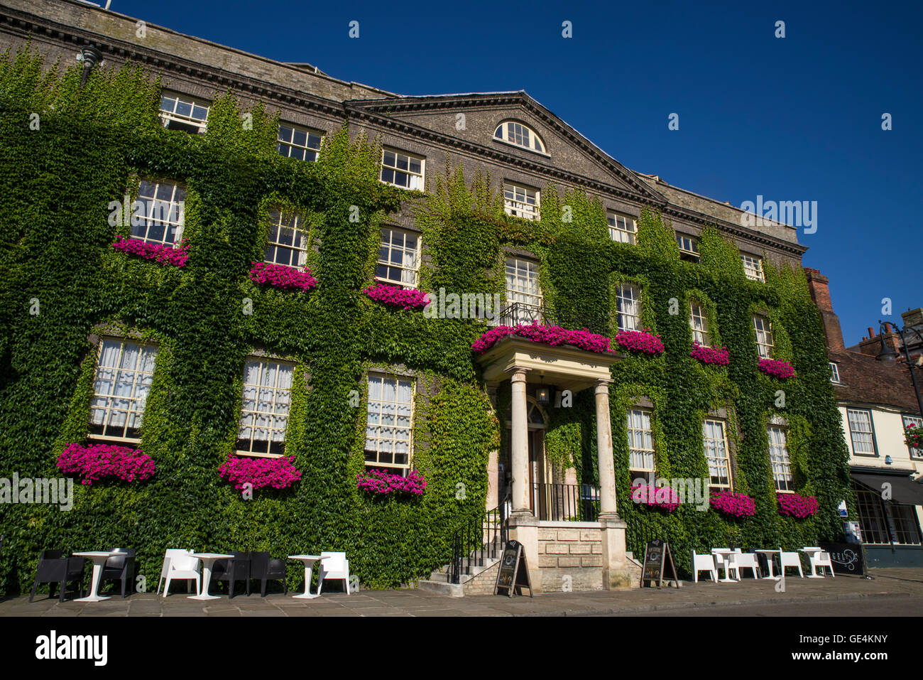 The impressive Georgian architecture of The Angel hotel in Bury St. Edmunds.  The hotel was used by Charles Dickens - Stock Image