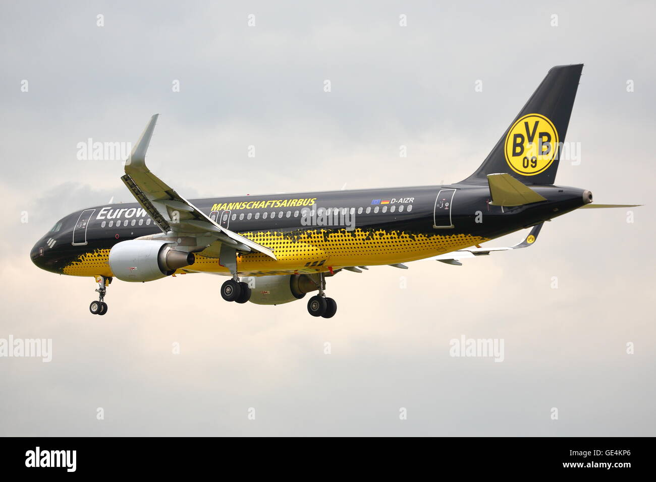 Eurowings Airbus A320-200 D-AIZR in Borussia Dortmund livery landing at London Heathrow Airport, UK - Stock Image