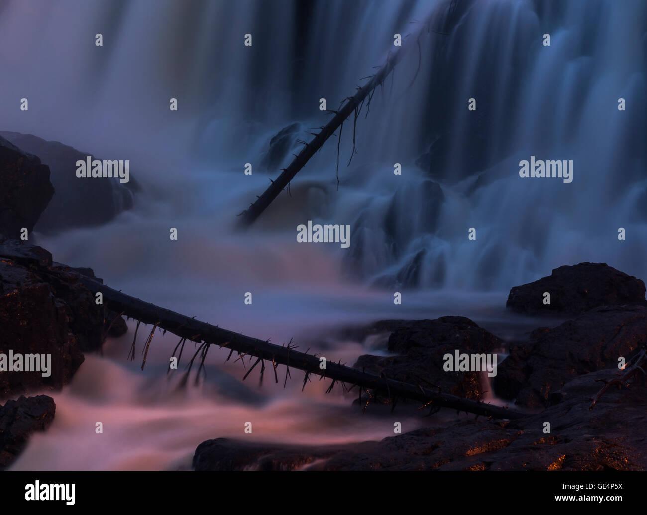 The Haugfossen, waterfall, at Blaafarveværket in  Åmot, Modum, Norway. Taken at night. Stock Photo